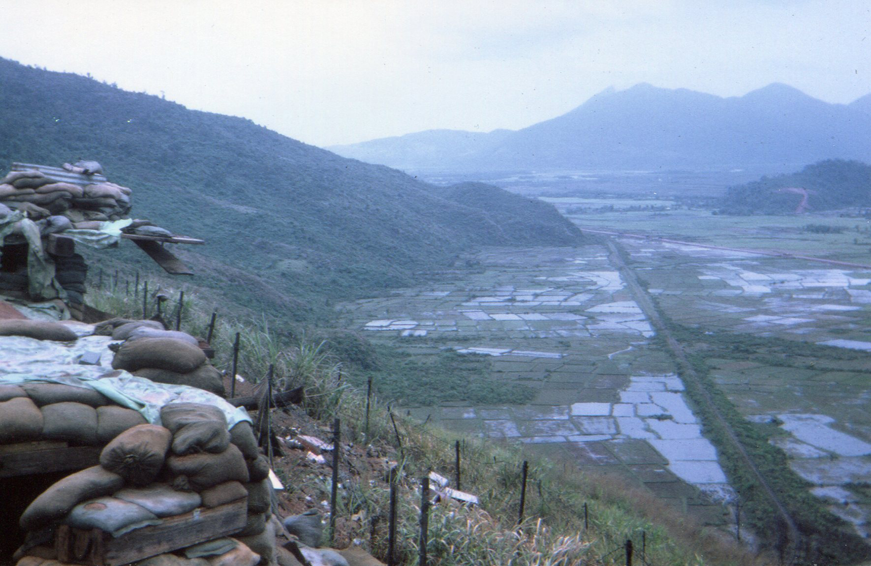 View from top level of Hill 90 overlooking rice paddies, French railroad, and highway #1 – photo taken March 1968