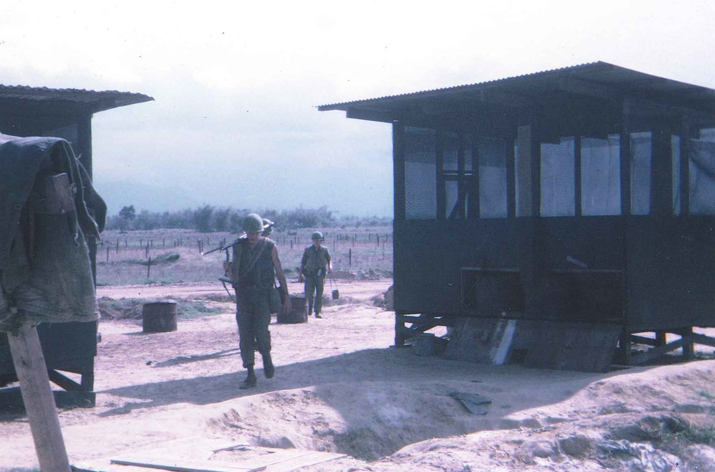 Patrol returning through south gate – An Loc December 1967