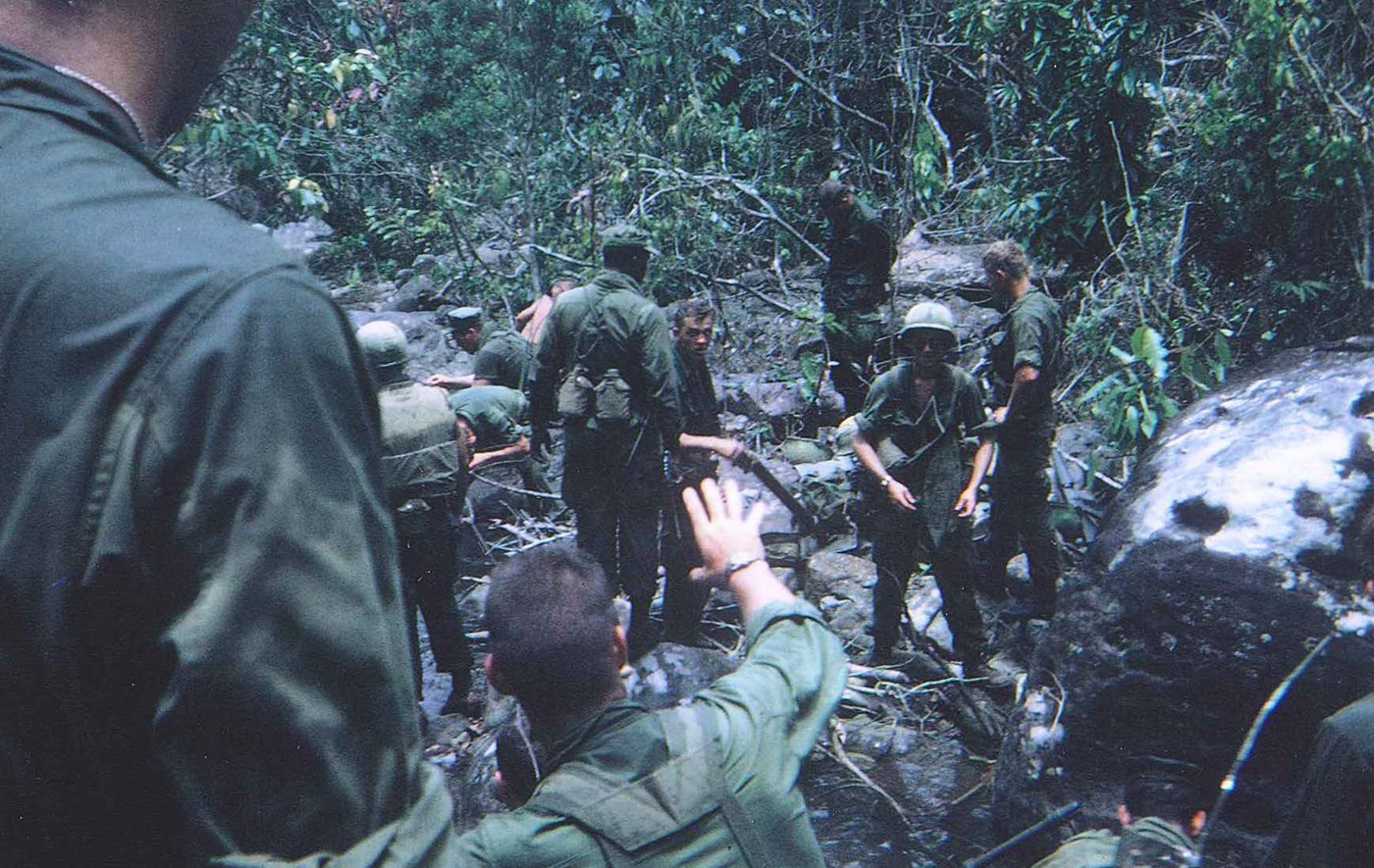 Patrol in mountain canopy near Hill 90 taking a water break – photo taken in February 1968