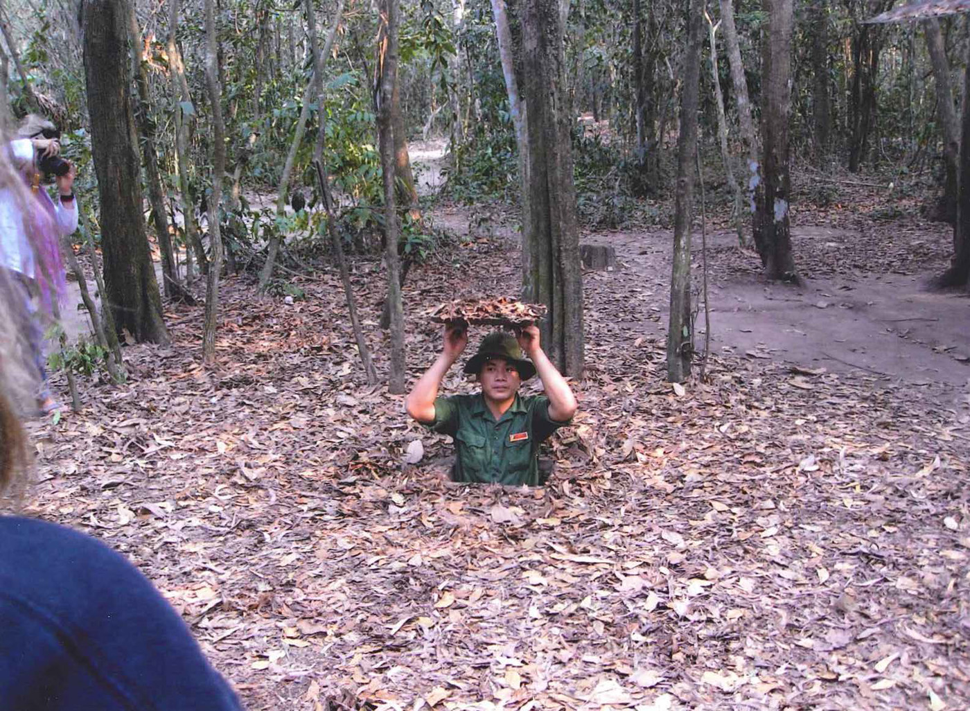 Spider hole demonstration at Chu Chi tunnels near Saigon – photo taken in March 2013